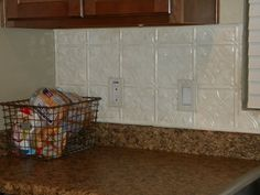 Good idea to use a chicken wire basket for storing stuff in the kitchen.Grand Design: Tour My Home Tin Tile Backsplash, Tin Tiles, Kitchen Storage, Kitchen Decor, Kitchen Ideas, Bath Remodel, Kitchen Remodel, Rainbow Vacuum, Grand Designs