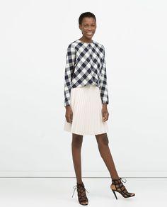 Zara: Pleated short skirt, checkered top, heeled sandals