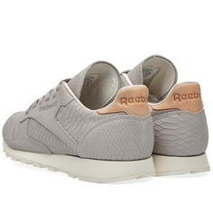 This luxurious rendition of the Reebok classic sneaker sees the soft leather uppers styled with a fish textured fabric and premium nubuck overlays. The low-cut construction and padded sockliner allow for greater movement and cushiony comfort the instant you step in. The die-cut EVA midsole for lightweight cushioning under the foot is rounded off by a high abrasion rubber outsole for maximum durability.  Soft Leather Uppers Fish Textured Nubuck Overlays Low-Cut Construction Padded Foam…