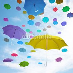 Flying  colorful umbrellas