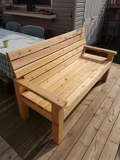 Was a pretty easy build! As others have stated, I recommend using lag bolts to attach the seat back to the legs. I used the same lags to attach the arm rests to the legs for aesthetics. Wooden Bench Plans, 2x4 Bench, Outdoor Wooden Benches, Diy Garden Furniture, Diy Outdoor Furniture, 2x4 Furniture, Concrete Furniture, Cardboard Furniture, Urban Furniture