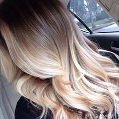 Frosted blonde balayage over light brown hair