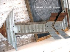Reclaimed wood and corrugated metal arrow by Chipping with Charm, featured on FunkyJunkInteriors.net