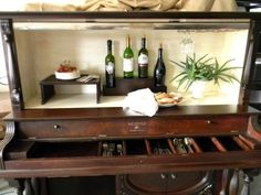 this buffet is made from an old stand up piano! so cute! look at all the compartments!
