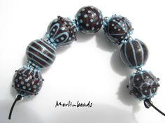Merlinbeads  Set of 7 rounds with dots and lines by Merlinbeads, $65.00