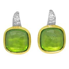 Pomellato earrings  Sherezade collection featuring peridot and diamonds set in 18K gold @ oakgem.com