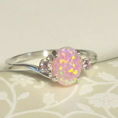 Perfect combination for spring! Custom ordered ring with a pink opal center stone and rose pink accent stones. Beautiful!
