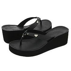 Casual black flops. These she packed in her bag.