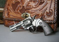 Vintage Colt 45 Python Revolver Belt Buckle by PassionFlowerVintage,Loading that magazine is a pain! Get your Magazine speedloader today! http://www.amazon.com/shops/raeind