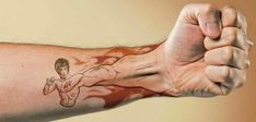 Absolutely awesome Bruce Lee tattoo; picture from Facebook