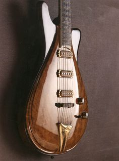 Jesselli custom guitar - Modernaire with leather wrapped pickups and brass accents