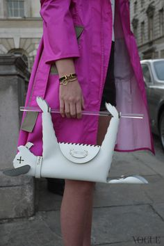 My street style photo at Vogue Italia Raincoat: Zagabo Leather short: David Lerner Bracelets: Hermés, Swarovski Bag: James Piatt