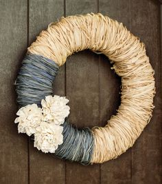 Decorate your door for Spring with a raffia #wreath with dahlias | Materials at Jo-Ann Stores