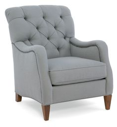 The Mia Club Chair comes standard with a deluxe seat cushion, welt trim and -7B brass nailhead trim.