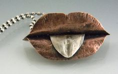 mouth by Isajul (donna Thome on Etsy). Sterling silver and copper