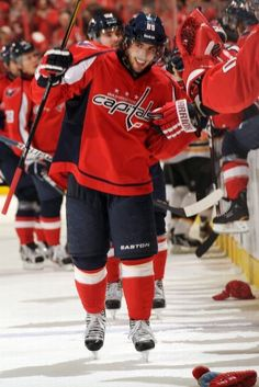 WASHINGTON, DC - JANUARY 24: Mathieu Perreault #85 of the Washington Capitals celebrates his third goal for the hat trick during the third period of an NHL hockey game against the Boston Bruins on January 24, 2012 at the Verizon Center in Washington, DC. (Photo by Mitchell Layton/NHLI via Getty Images)