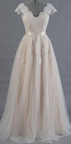 7d6b57cbb22 This beautiful lace boho   vintage style bridal gown with v-neck front
