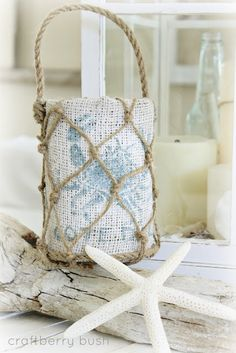 beachy lantern. I'm thinking diy tin can covered by stenciled linen or burlap and with jute netting tied around