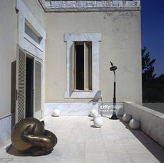 http://media.gettyimages.com/photos/white-marble-terrace-at-the-suburban-athens-greece-home-of-art-a-picture-id592331611