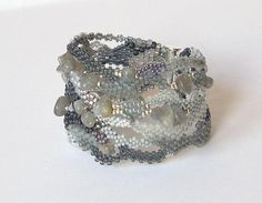 This beautiful gray freeform peyote bracelet with the original design made of Czech seed beads and Japanese seed beads TOHO. I have used many varieties of gray colors beads and natural gemstone Labradorite. The magnetic clasp is easy to use. This bracelet is perfectly combined with the