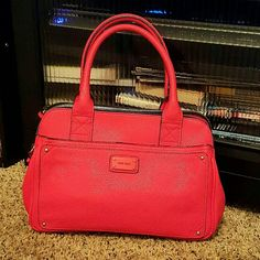 Red Nine West Convertible Handbad This Handbad is in great condition. The color is beautiful, it is a deep rich red with a hint of orange undertones.  The bag measures about 8inch tall and 6 inches wide and includes 3 compartments with the middle one zipping, the 2 outer ones snap close and a smaller pocket on the front of the bag. Nine West Bags Mini Bags