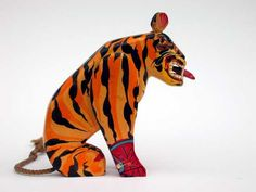 Wooden tiger by Sam Smith (1908-1983).