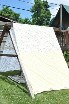 A homemade swing set tent from old sheets