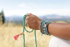 A Mala is a string of beads used to count mantras (Sanskrit prayers) in sets of 108 repetitions. A mantra is a word or series of words chanted aloud or silently to invoke spiritual qualities. Silver Sage, Yoga Philosophy, Sanskrit, Yoga Inspiration, Mantra, Namaste, Count, Meditation, Prayers