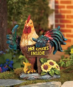"""Solar Rooster Statue points the way to the party with his humorous light-up sign reading """"Hot Chicks Inside."""""""