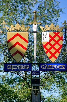 An ornate iron-worked sign in Chipping Campden, Gloucestershire, England. My students used to design their own coats of arms as part of a unit on the Middle Ages. England And Scotland, Scotland Uk, England Uk, St Just, English Village, Iron Work, English Countryside, British Isles, Coat Of Arms