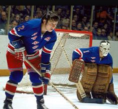 Giacomin squares up to a face-off with Brad Park. Early 70s.