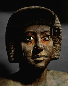Old Kingdom (5th Dynasty), 2475 BCE, Ancient Egypt, Wooden Sculpture.  Such a handsome, beautiful face. It seems familiar to me.