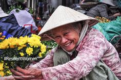 Part of our #ResilientWomen series, this photo of a lady selling flowers in a market in Vietnam. photo credit: Amanda Nero