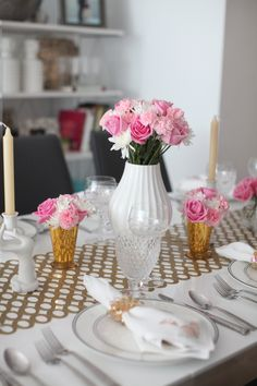 Pretty in Pink Table - Chilewich table runner, Jonathan Adler White vases filled with Carnations, roses, and pom poms