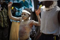 A refugee boy from a Sudanese tribe showing their style of dancing.  Photo by Iftekhar Rashid