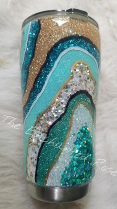 If you really want to make a glittery statement, look no further. This tumbler is stunning with different shades of teal glittery and varying textures. If you love all things purple and bling, this is for you! My tumblers are crafted with all kinds of fun materials! I use paint, glitter, vinyl,