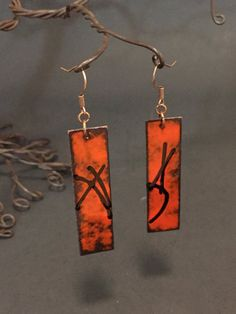 """Red enameled copper earrings with glass threads, torch and kiln fired, 2""""x1/2"""""""
