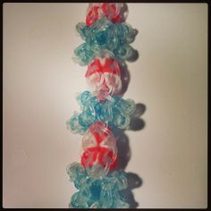 "SNOWFLAKES and PEPPERMINTS Rainbow Loom bracelet. Designed and loomed by Sara Shubnell. Found on Rainbow Loom FB page.  Sara Shubnell said ""If you can make the flower tower bracelet and the feet for action figures, you can make this. ...I'm going to try something similar and...add a snowflake crystal to the top and and bottom of the starburst, giving each snowflake 6 crystals.  Photo tutorial coming. Crazy Loom Bracelets, Rainbow Loom Bracelets, Rainbow Loom Patterns, Rainbow Loom Creations, Loom Bands Designs, Wonder Loom, Loom Love, Flower Tower, Rubber Band Bracelet"