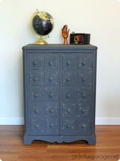 Pottery Barn Inspired Apothecary Cabinet ~ Add wood panels and knobs to a plain cabinet to make it look like an apothecary cabinet. No power tools were even used for this one!