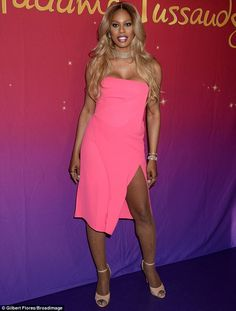 Making an incredible entrance:The 32-year-old revealed her ample cleavage and toned legs in a hot pink strapless dress with a diamond choker and red lipstick at the unveiling