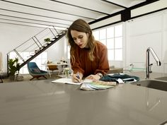 """Fashion and Architecture Blogger, Macarena Gea, reviews designs on her Silestone Unsui Suede finish countertop. This is one of many ads in the 2013 Silestone campaign """"Authentic Life."""""""