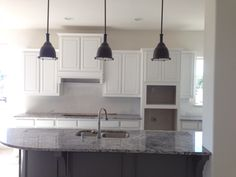 Pendant lights, white cabinets, level 4 granite, (has beige)