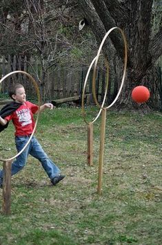 We made Quidditch for the backyard a lot like this one. We used PVC pipe over a stake in the yard instead of wood.