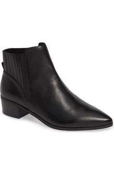 6439a0c4ea1 A heel counter wrapped in goring sets this sleek pointy-toe bootie apart  from the
