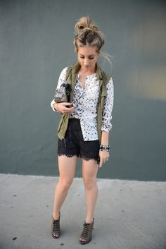 """""""I always feel best in outfits that are well balanced with pieces that are both fancy and casual. This one felt right from head to toe with unfussy hair, sparkly studs, a polished blouse (I love the snow leopard print), a utilitarian vest, lace shorts, and a glitzy clutch.""""  Emily of Cupcakes and Cashmere."""