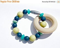 About Us-  We take pride and make 100% of our teething silicone and nursing necklaces here in house. We strive to having the best product 100% of the time. I am always searching for new color and trends when purchasing my -North American maple and FDA approved food grade silicone bead. -Break away clasp -Your choice of knotting - end knots or individual knots (a knot in between each bead) or as pictured -Sized 9mm to 18mm. -Soft on babies gums and teeth -No BPA, phthalates, cadmium, lead…