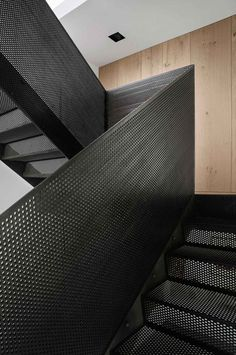 Perforated black steel balustrade | stairs | design |  Peter's House in Copenhagen by Studio David Thulstrup | Yellowtrace
