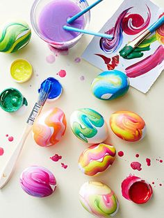 Kids can brush squiggles of Crayola washable tempera paint on boiled white eggs with a 1/2-wide flat paintbrush.
