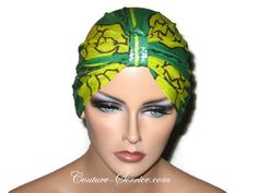 Green Chemo Turban, Handmade Metallic Abstract by Couture Service Size Small.For that special occasion! The camera is unable to show the silvery sheen that overlays the green.Ultra light weight. Turban has knot, hand pleated back, hand gathered front, and finished hemline. Accented by a lovely petite floral pin.This is the actual turban that you will receive. Small fits a 21 to 21 1/2 inch head. The mannequin has a 22 inch head.Turban specifically designed for those who have experienced hair…