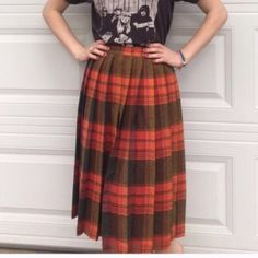 Pleated hand made plaid skirt. Orange tones Xs 70s 12 inch waist 27 inches long hand made pleated skirt. Very pretty Color. Vintage retro throw back. Shirt model is wearing is for sale in separate listing. Bundle both items and save on shipping ⭐️ Vintage Skirts Midi